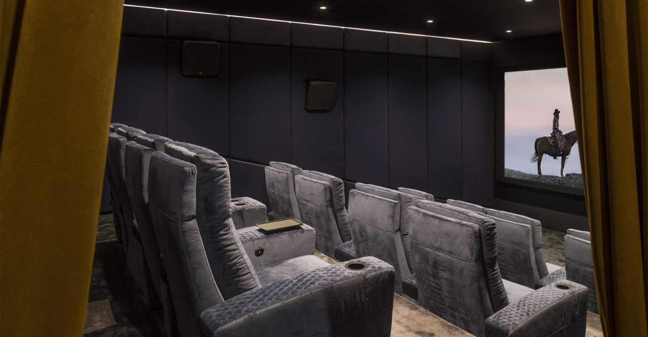 Luxury Home cinema with Ferrier seating. Roland Koller Signature Design curtains entrance cineak