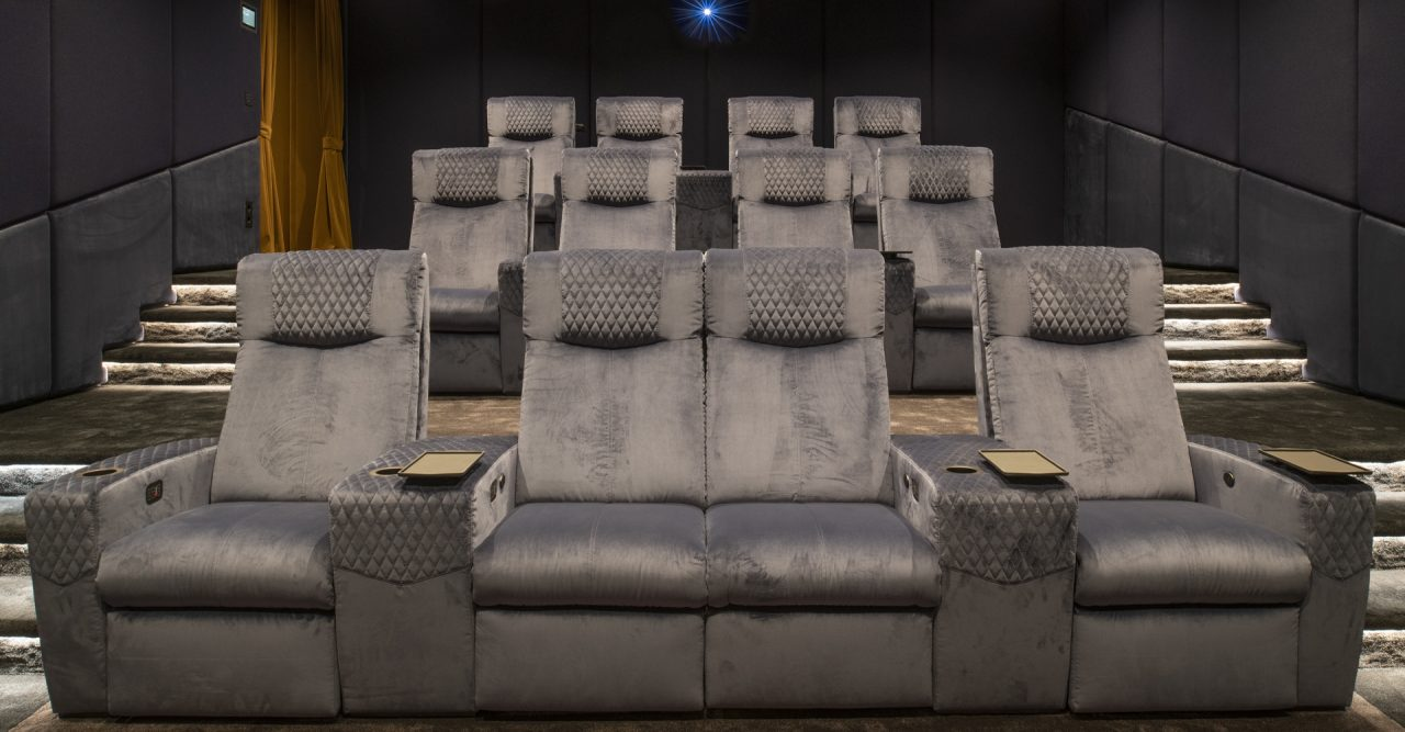 Luxury Home theatre with Ferrier cineak seating. Roland Koller Signature Design front