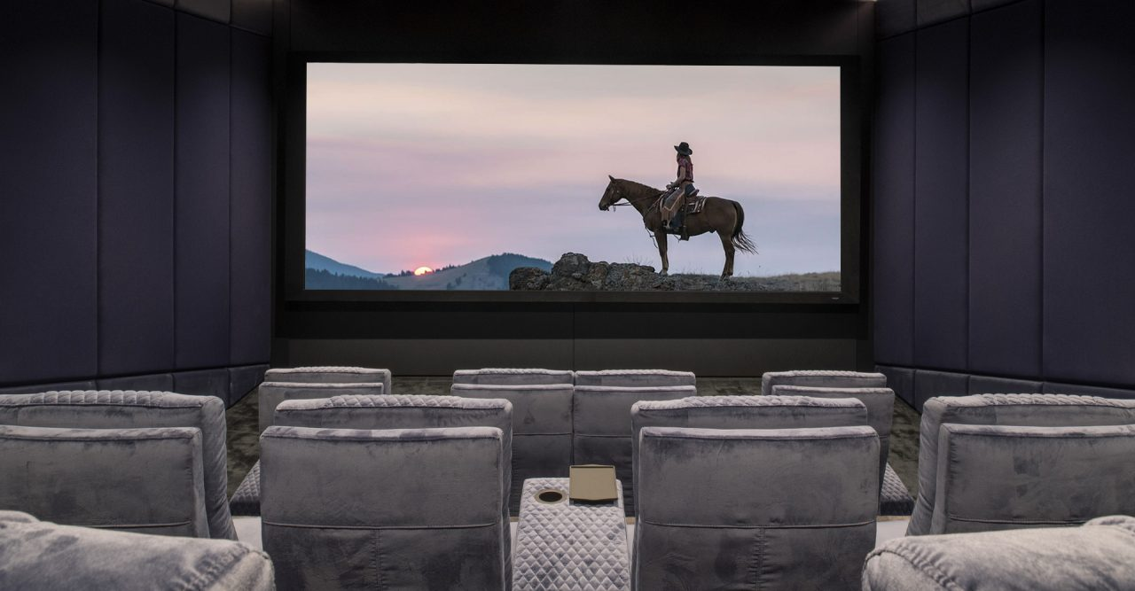 Luxury Home theater with cineak Ferrier seating. Roland Koller Signature Design