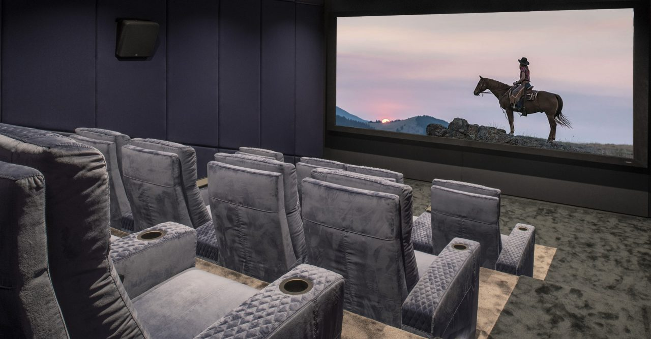 Luxury Home cinema with Ferrier theater seating. Grey plushy Roland Koller Signature Design